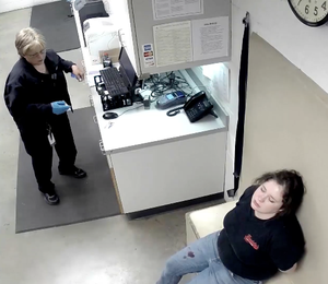 Adacia Chambers waits in the Stillwater Police Department booking area on Oct. 24 less than two hours after a car, reportedly, driven by her crashed into crowds of people at the OSU Homecoming parade. (photo taken from a booking video provided by the Stillwater Police Department.)