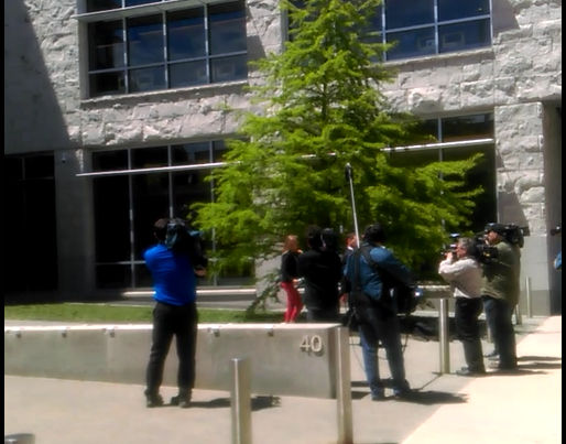 Michelle Carter (in red attire) leaving court